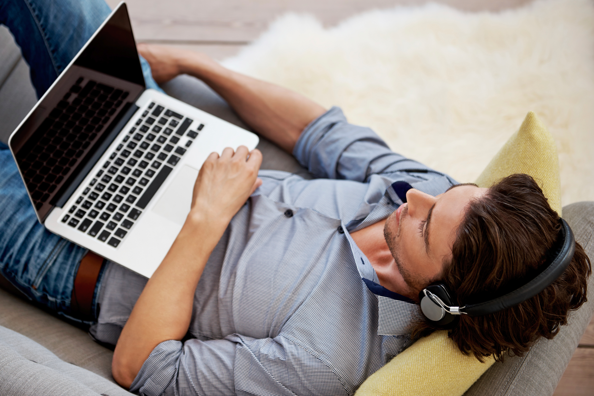 Man-relaxing-with-music-and-laptop.png