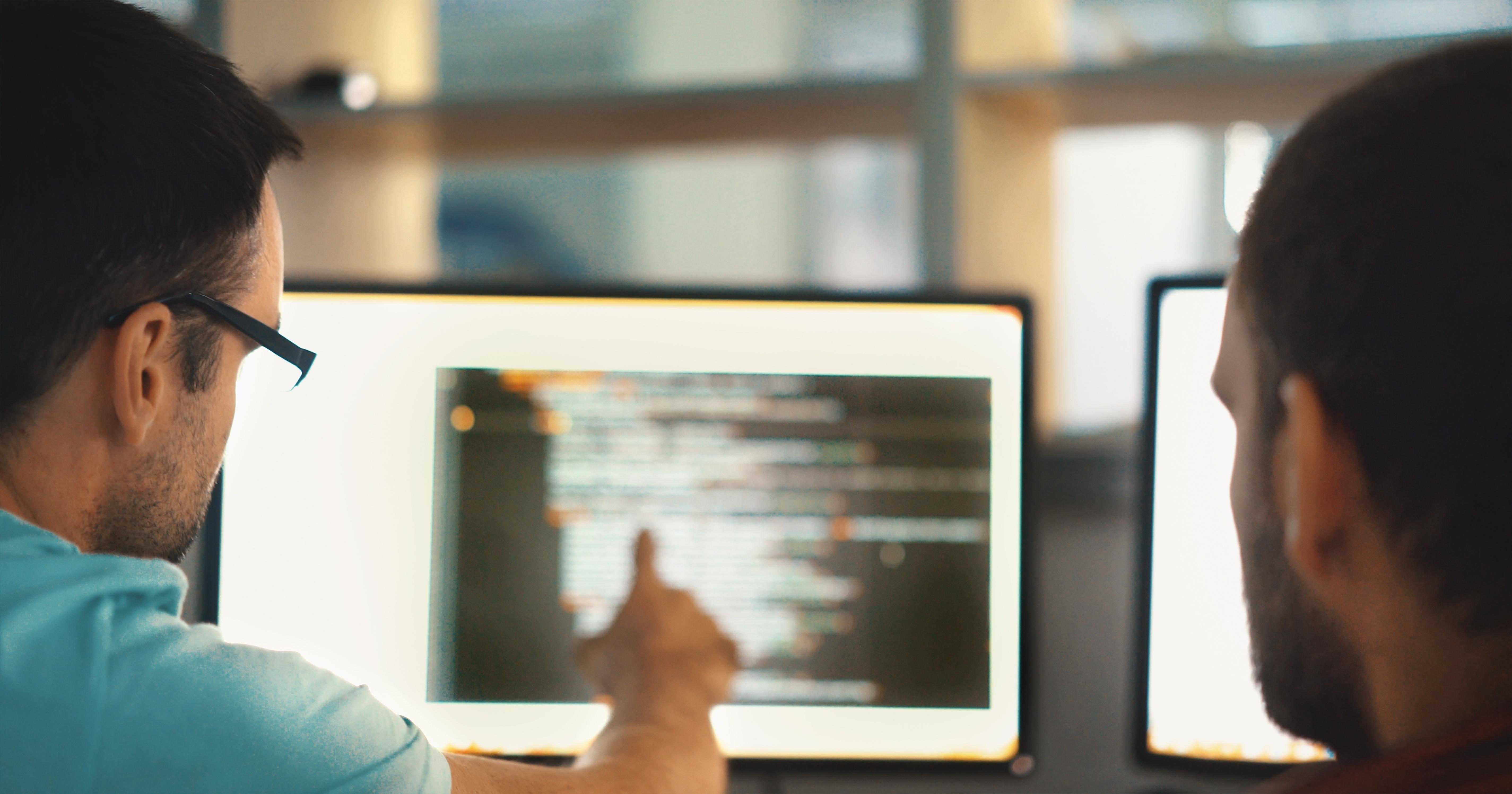 engineers-looking-at-code.jpg