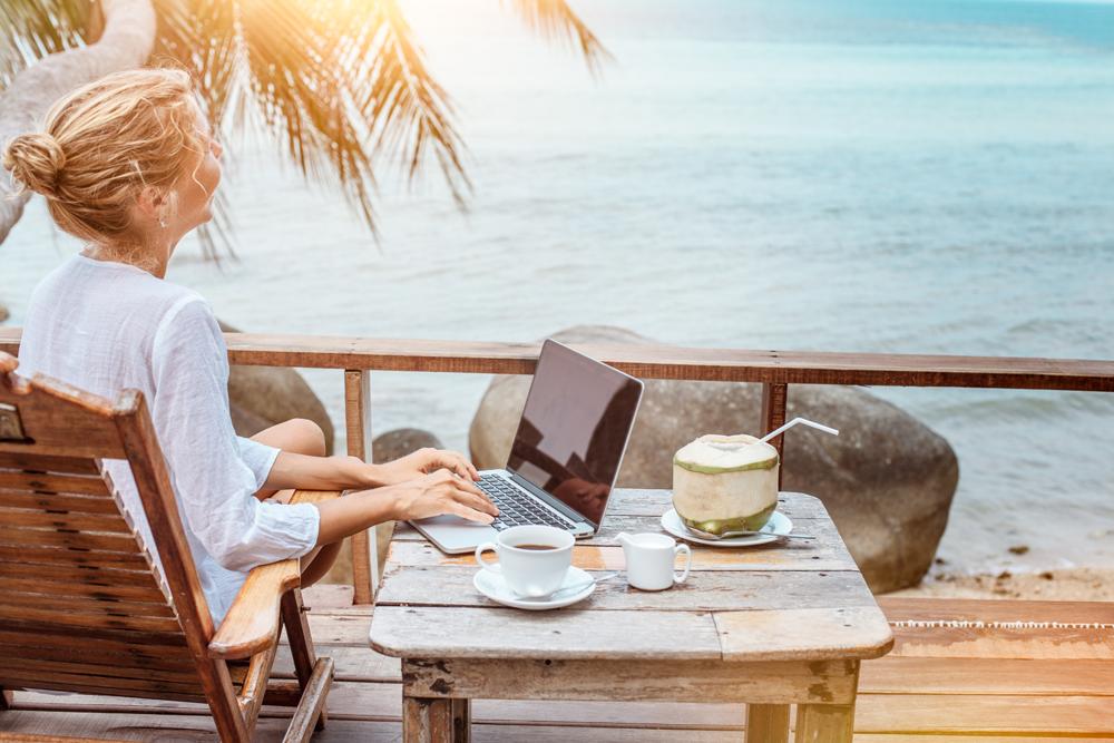 woman-beach-laptop-coconut.png